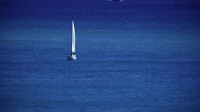 Sailboat in the ocean stock video footage