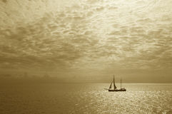 A sailboat on the ocean in summer sailing stock photography
