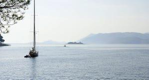 A sailboat off the coast Stock Photos
