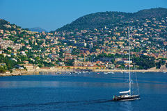 Sailboat off the French Riviera. A luxury sailboat sailing off the coast of the French Riviera Royalty Free Stock Photography