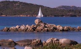 Sailboat off island of Caprera Royalty Free Stock Image