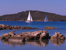 Sailboat off island of Caprera Stock Photography