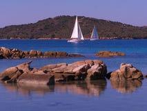 Sailboat off island of Caprera. Sailing in the beautiful bay on the island of Caprera Stock Photo