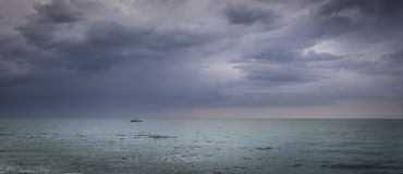 Sailboat in open sea before storm Royalty Free Stock Photos
