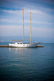 Sailboat over blue. Sailboat moored at a dock in Galicia, Spain Royalty Free Stock Image