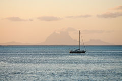 Sailboat on the Pacific Ocean. Sailboat floats on the Pacific Ocean at sunset Royalty Free Stock Photography