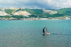 Sailboat and panorama of Novorossiysk commercial sea port Stock Images