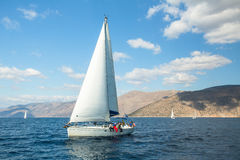 Sailboat participate in sailing regatta 12th Ellada Autumn 2014 among Greek island group in the Aegean Sea. HYDRA, GREECE - CIRCA OCT, 2014: Sailboat participate royalty free stock images