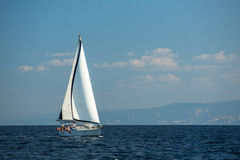 Sailboat participate in sailing regatta 12th Ellada Autumn 2014 among Greek island group in the Aegean Sea. HYDRA, GREECE - CIRCA OCT, 2014: Sailboat participate royalty free stock photography