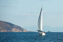 Sailboat participate in sailing regatta 12th Ellada Autumn 2014 among Greek island group in the Aegean Sea. HYDRA, GREECE - CIRCA OCT, 2014: Sailboat participate royalty free stock photos