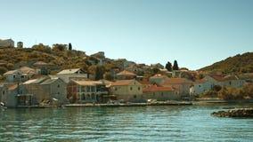 Sailboat floating along the Dalmatian Coast stock video footage