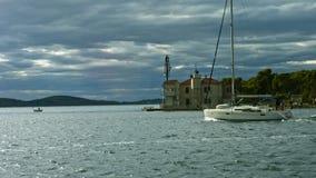 Sailboat floating along the Dalmatian Coast stock video