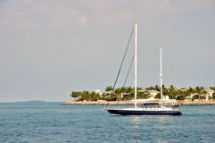 Sailboat passing between Key West and Sunset Key Stock Image
