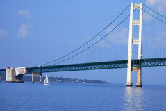 A Sailboat Passing The Mighty Mac. A Span of The Mighty Mac, with a sailboat Stock Image