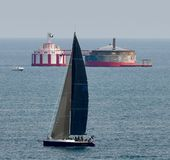 Sailboat Passing Water Crib. This is a Summer picture of a sailboat passing the iconic North Avenue Water cribs on Lake Michigan  off Chicago, Illinois in Cook Royalty Free Stock Photos