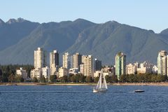 Sailboat Past Vancouver Skyline Stock Photo