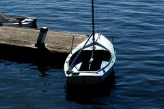 Sailboat at pier. Sailboat resting at pier at the charles river in boston massachusetts Stock Photography