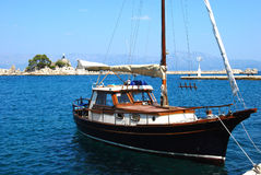 Sailboat in port. Small sailboat in Mediterranean port in summer day royalty free stock photos