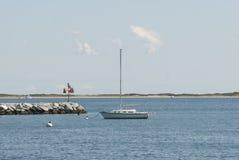 Sailboat At Provincetown Harbor. A sailboat anchors at Provincetown Harbor, Massachusetts stock photography