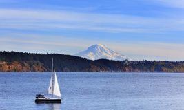 Sailboat on Puget Sound with Mt. Rainier stock photography