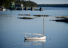 Sailboat in quaint and rural fishing village stock photos