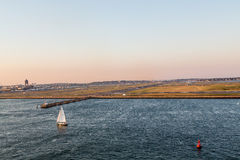 Sailboat and Red Channel Marker by Boston Airport Stock Images