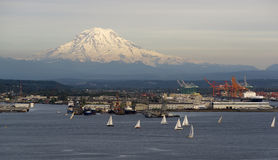 Sailboat Regatta Commencement Bay Puget Sound Mt Rainier Tacoma. An evening boat race is conducted on the waters of Puget Sound Tacoma Washington Stock Photography