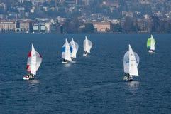 Sailboat regatta race with colorful spinnaker sails at lake Luga Royalty Free Stock Photo