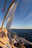Sailboat during the regatta at sunset ocean Royalty Free Stock Images
