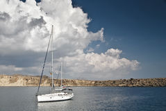 Sailboat at Rest with Fluffy White Clouds Stock Photography