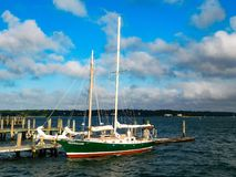 Sailboat Resting At The Dock In SUmmer. A sailboat at rest docked at Greenport New York on Long Island royalty free stock photos