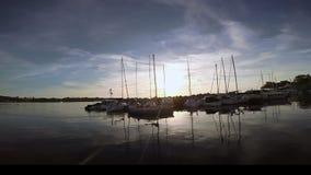 Sailboat return to harbour Stock Photo