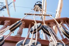 Sailboat rigging system consisting of pulleys. Planks, masts and ropes royalty free stock photos