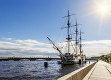 A sailboat on the river Neva and the Troitsky Bridge in Saint Pe Royalty Free Stock Image