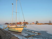 Sailboat in river in winter ice Stock Photography