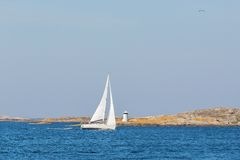 Sailboat in rocky archipelago Royalty Free Stock Images