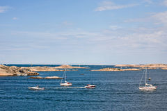 Sailboat and rocky coast Royalty Free Stock Photo