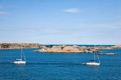 Sailboat and rocky coast Royalty Free Stock Image