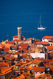Sailboat and Roofs. Roofs of a typical town in Southern Europe and a sailing boat Stock Photography