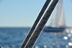 Sailboat ropes. Ropes on a boat in the sea Royalty Free Stock Images