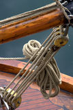 Sailboat ropes and pulleys. Details of ropes and pulleys on an old sailboat Stock Images