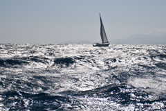 Sailboat on rough sea Stock Image