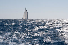 Sailboat on rough sea Royalty Free Stock Photos