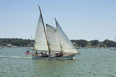 Sailboat. Sailing along shore in harbor Royalty Free Stock Photo