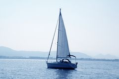 Sailboat sailing in blue mediterranean sea Stock Photo