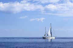 Sailboat sailing on blue sea horizon ocean Royalty Free Stock Photo