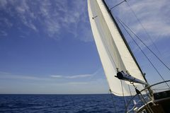 Sailboat sailing blue sea on sunny summer day Royalty Free Stock Photography
