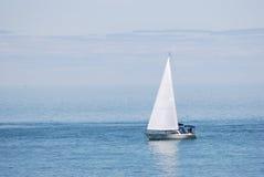 Sailboat. Sailing in blue water Stock Photos
