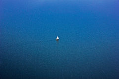 Sailboat. A sailboat or sailing boat is a boat propelled partly or entirely by sails smaller than a sailing ship Stock Photo