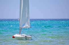 Sailboat. Sailing boat in the clear sea of Sardinia heavenly good day sunshine Royalty Free Stock Images